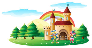 Two clowns in front of a castle Royalty Free Stock Image