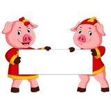 Two cute pigs are holding the white board for chinese new year royalty free illustration