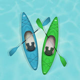 Two kayaks and paddle Stock Photography