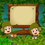 Two soldiers with guns in the jungle with wooden signboard. Illustration of Two soldiers with guns in the jungle with wooden signboard Stock Photos
