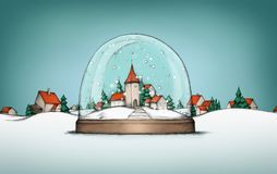 Village in snow globe with village landscape in background Stock Photos