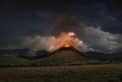 Illustration of volcano. Eruption against a dark sky with rainbow Royalty Free Stock Photography