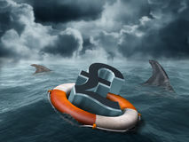 Vulnerable pound. Illustration of a vulnerable sterling pound being circled by sharks Royalty Free Stock Photo