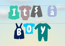 Its a boy. Illustration of a washing line with baby clothes and words saying It's a Boy Royalty Free Stock Image
