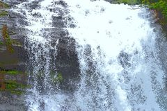 Forceful Flow of Water with Sprinkling of White Drops - Waterfall Illustration royalty free stock images