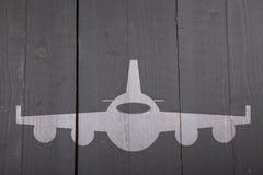 Illustration of white airplane on black wooden background Stock Photo