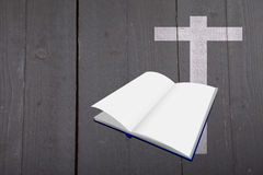 Illustration of white bible and cross on black wooden background Stock Images