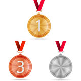 Illustration of winner medals. Set of gold, silver and bronze medals with red ribbons. Three isolated illustrations on gray background Royalty Free Stock Image