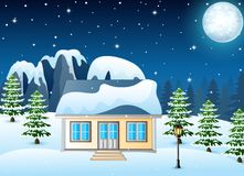 Winter night landscape with snow covered house and snowy rocks Royalty Free Stock Photo