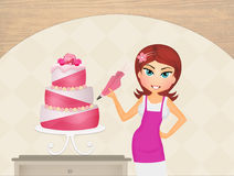 Woman decorating cake Stock Images