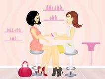 Women in a beauty salon getting a manicure Royalty Free Stock Photo