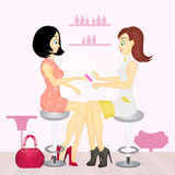 Women in a beauty salon getting a manicure Royalty Free Stock Image