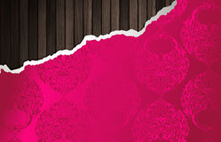 Wooden wall and pink ornamental wallpaper Stock Photos