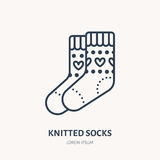 Illustration of woolen socks. Knitted clothing shop line logo. Vector flat sign for atelier or garment shop Royalty Free Stock Photos