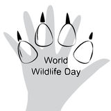 Illustration of World Wildlife Day with Animal Footprint. Black and White  Illustration of World Wildlife Day with Animal Footprint and Human Hand Royalty Free Stock Images