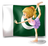 A young ballet dancer in front of the Pakistan flag Royalty Free Stock Images