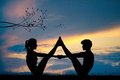 Young couple makes yoga at sunset. Illustration of young couple makes yoga at sunset Stock Photo