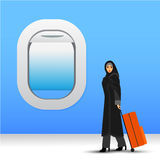 Illustration of a young fashionable muslim woman with suitcase and travel bag. Royalty Free Stock Photo