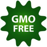 Illustrationen av ett grönt emblem för GMO frigör mat Royaltyfria Foton
