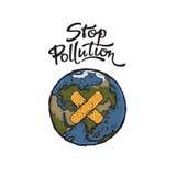 Illustrationen av planetjord och stoppar föroreningbokstäver Arkivfoton
