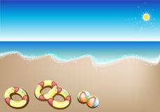 Illustrationen av uppblåsbaret ringer, och stranden klumpa ihop sig Arkivfoto
