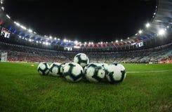 illustrationen f?r bollar 3d framf?rde fotboll royaltyfri bild