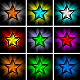 Illustrations of colorful shining stars Stock Images