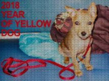 Illustrations. Cross-stitch. Yellow dog. Royalty Free Stock Images