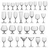 Uppsättning av tomma glass bägare och wineexponeringsglas Arkivfoto