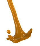 Caramel syrup topping splash Royalty Free Stock Photography