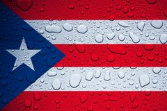 PUERTO RICO, CARIBBEAN, 23 September 2017 - Hurricane Maria leaves island under water. World weeps. Illustrative editorial image of flag and rain drops Stock Photography