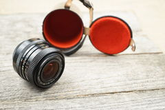 Illustrative, editorial photo of old cameras and lenses Royalty Free Stock Image