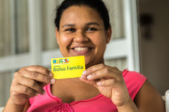 Illustrative editorial of a woman showing Bolsa Familia Card. Bolsa Familia is a social welfare program of the Brazil. Ian government, part of the Fome Zero Stock Photography