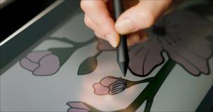 Graphic designer draw flower illustration on drawing tablet. digital artist at work