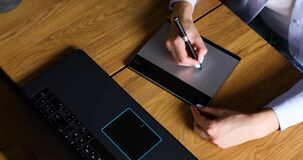 Illustrator hands scetching on tablet computer, using stylus