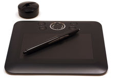 Illustrator Tablet. Illustrator's tablet with pen for drawing s and 3D shapes on a white background Stock Images