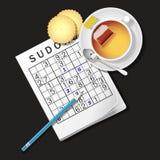 Illustrazione del gioco di Sudoku, tazza di tè e cracker Fotografia Stock