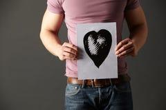 Illustrazione dell'inchiostro della holding dell'uomo del cuore Immagine Stock Libera da Diritti
