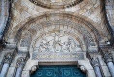 Illustrazione della cattedrale di Sacre Coeur sopra l'entrata Fotografia Stock