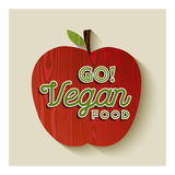 Illustrazione di concetto della mela del vegano con l'etichetta del testo Fotografie Stock