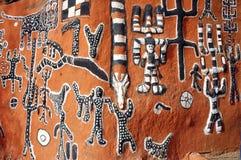 Illustrazione di Dogon dal lato di una costruzione Immagini Stock Libere da Diritti