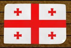 Illustrazione di una bandiera georgiana dipinta sul più papier incollato sopra fotografia stock