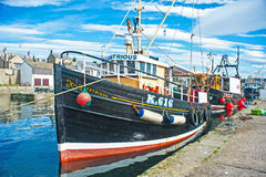 Illustrious berthed at Burghead. The fishing boat Illustrious tied up at Burghead harbor a port on Scotland's East Coast royalty free stock image