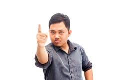 Ilsken affärsman i dräkt som pekar på dig arkivfoton