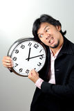 Ilsken affärsman klockan arkivbild