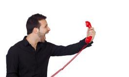 Ilsken affärsman som ropar på telefonen Arkivfoto