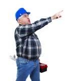Ilsken arbetare som pekar på något Arkivfoton