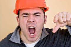 ilsken byggnadsarbetare arkivfoton