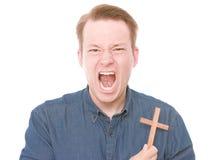 Ilsken kristen arkivbild