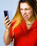 ilsken kvinna för spänning för affärstelefonskri arkivbild